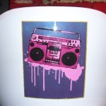 Boombox airbrush and brush on chair